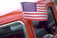 American flag blowing in the Ford.