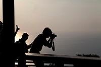 Toursits watching Sunset on Phuket, Thailand