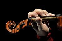 Close up of man playing violin.