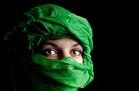 Eyes of girl with green turban