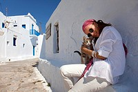 Woman with a local cat, Amorgos, Cyclades Islands, Greek Islands, Greece, Europe.