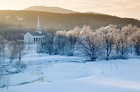 Sunrise over Stowe Community Church on a cold winter morning, Stowe, Vermont, USA.