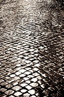Wet cobbled road, Rome, Italy.