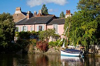 Boats and House on River Avon, Christchurch, Dorset, England, UK.