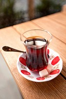 Traditional Turkish tea cup on the table in Grand Bazaar, Sultanahmet, Istanbul, Turkey,.