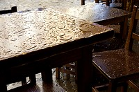 Raindrops on a wooden table.