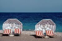 Deckchairs & Umbrellas or Parasols on Deserted Beach Rhodes Greece.