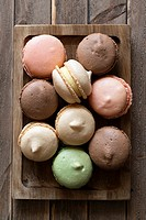 Macarons, a sweet meringue-based confection made with eggs, icing sugar, granulated sugar, almond powder or ground almond, and food colouring.
