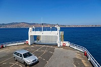 Ferry boat heading towards Messina Tremestieri ferry port of Sicily from Reggio di Calabria ferry port, Strait of Messina, Calabria, Southern Italy, I...