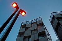 Streetlight at sunset, residential building, Barcelona, Catalonia, Spain