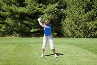 Senior woman golfing, Model Released, Bobcaygeon, Ontario, Canada.