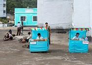 Women Selling Food In The Street, Hamhung, North Korea.
