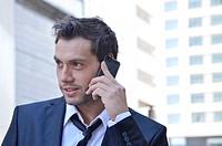 Businessman talking on mobile phone.