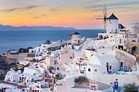 View of Oia with traditional greek windmill of Santorini, Oia Village, Santorini, Aegean Island, Cyclades Islands, Greek Islands, Greece, Europe.