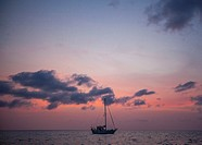 Belize, sailboats on the Caribbean at Sunset.