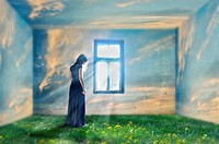 Composite image of a woman standing by the window and grass and clouds.