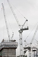 Several cranes on a construction site in Southwark, London Bridge, London, England, UK.