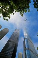 Sunbeams reflecting through fog. Trump International Hotel and Tower. Chicago Illinois. Adrian Smith architect. AMA formerly IBM Plaza at left, last U...