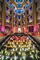 The multicoloured entrance lobby and fountain detail of the 7 star Burj Al Arab Hotel designed by the architects Atkins, Um Suqaim Second, Dubai, The ...