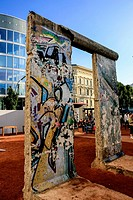 A piece of the graffitti covered Berlin wall on display near Checkpoint Charlie.