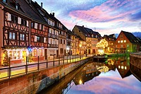 Christmas decoration by night at the Little Venice. Colmar. Wine route. Haut-Rhin. Alsace. France.