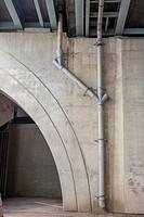 Pipes under a bridge.