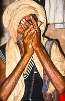 sadhu smoking tjilm in kolkata, india