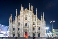 Duomo di Milano and a woman light paint a heat in Lombardy, Italy.