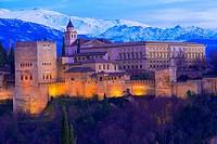 Alhambra, UNESCO World Heritage Site, Sierra Nevada and la Alhambra at Dusk, Granada, Andalusia, Spain.