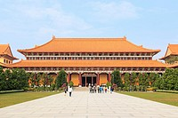 Kaohsiung, Taiwan: Fo Guang Shan buddist temple of Kaohsiung, Taiwan with many tourists walking by.