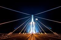 Swietokrzyski bridge illuminated at night with advertising balloon in sky, Warsaw, Poland, Central Europe.
