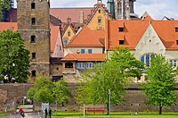 Ulm, Germany - view of the historic waterfront at the river Danube showing the city walls, conservatoire, Leaning Tower, townhall and cathedral.