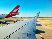 Tail of a plane from the Australian airline Qantas, view from another plane. Darwin International airport, Northern Territory, Australia.