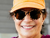 Senior woman in sunglasses and hat