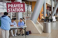 "Warren, Michigan - Christian activists operate a """"prayer station"""" in the lobby of city hall. A few steps away, atheists staff a """"reason station. """"..."