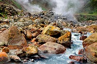 Small river winding down the hill through big rocks, coming from a hot spring of volcanic origin, with mineral rich water, Valley of Desolation near t...