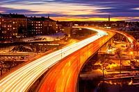 Sweden, Stockholm - Traffic on Essinge Highway at Dusk.