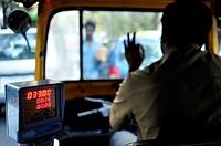 auto-rickshaw in traffic, Bangalore or Bengaluru, Karnataka, India.