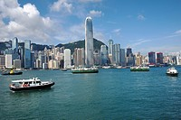 boats on Victoria Harbour with Hong Kong city skyline, China.