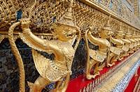 Garuda and Nagas, at the outside of the ubosot of Wat Phra Kaew - Temple of the Emerald Buddha; full official name Wat Phra Si Rattana Satsadaram, the...