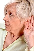 Elderly woman listening.