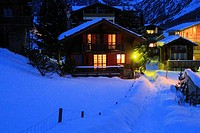 Traditional wooden chalets at night, Saas Fee, Alps, Swtzerland.