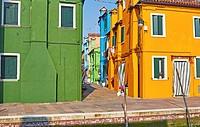 Traditional alleyway between orange and green painted houses, Burano, Venetian Lagoon, Veneto, Italy, Europe.