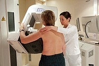 Radiology technician performs mammography test by xray.