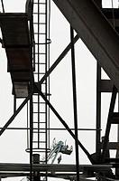 Crane construction with crane in background, Hamburg harbor, Germany.
