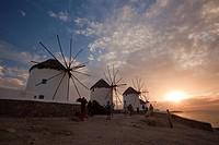 Traditional windmills in Mykonos town at sunset, Mykonos, Cyclades Islands, Greek Islands, Greece, Europe.