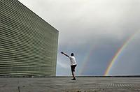 man practising Tai-Chi on esplanade of Kursaal Congress Centre and Auditorium by Spanish architect Rafael Moneo, San Sebastian, Bay of Biscay, provinc...