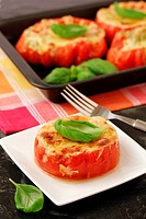 Stuffed tomatoes with basil.
