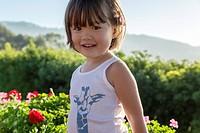 Three year old girl wearing a printed tank top, La Jolla, California.