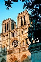Paris, France, Religious Architecture, Notre Dame Cathedral, Front, Towers in Sunset light, Statue.